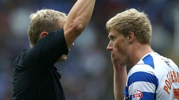 Referee Mr G. Scott shows a red card to Reading's Pavel Pogrebnyak (PA Sport)