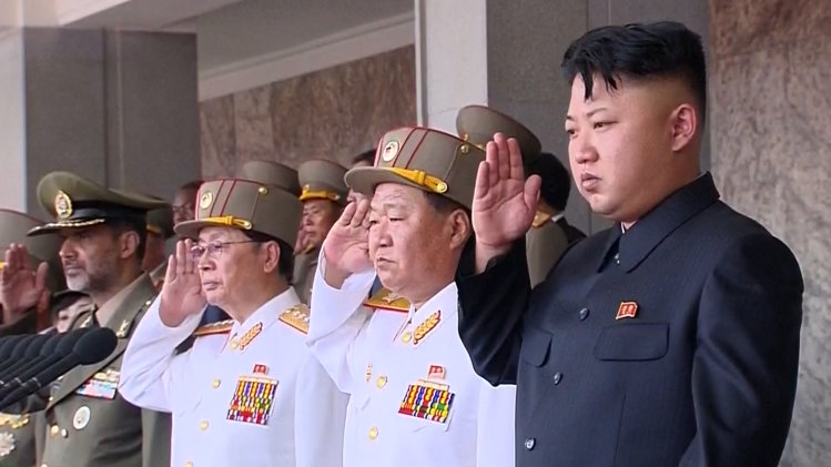 In this image made from video, North Korean leader Kim Jong Un, right, salutes during a military parade marking the 60th anniversary of the Korean War armistice in Pyongyang, North Korea, Saturday, July 27, 2013. Goose-stepping soldiers, columns of tanks and a broad array of ominous-looking missiles poised on mobile launchers were paraded through the streets of Pyongyang on Saturday in a painstakingly choreographed military pageant intended to strike fear into North Korea's adversaries and rally its people behind young ruler Kim Jong Un on the 60th anniversary of the armistice that ended the Korean War. (AP Photo/KRT via AP Video) TV OUT, NORTH KOREA OUT