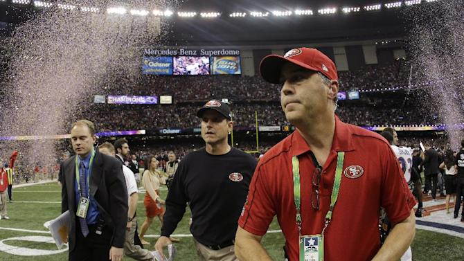 San Francisco 49ers head coach Jim Harbaugh, center, walks off the field after their 34-31 loss to the Baltimore Ravens in the NFL Super Bowl XLVII football game, Sunday, Feb. 3, 2013, in New Orleans. (AP Photo/Matt Slocum)