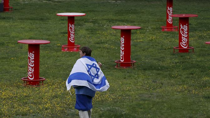 A person walks with an Israeli flag during the Chess competition during the 14th European Maccabi Games at the Olympic park in Berlin