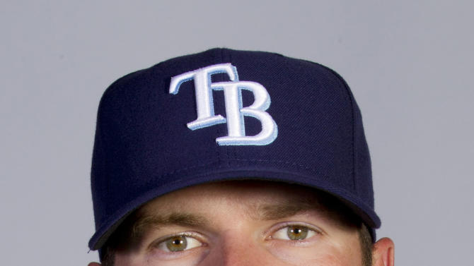 FILE - This 2011 file photo shows showing Tampa Rays baseball player  Wade Davis. The Kansas City Royals have acquired starting pitchers James Shields and Davis from the Tampa Bay Rays for outfielder Wil Myers and a package of minor league prospects, Sunday Dec. 9, 2012. (AP Photo/Dave Martin, File)