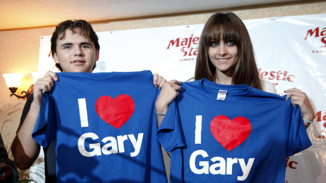 Prince, left, and Paris Jackson, son and daughter to the late pop icon Michael Jackson, display T-shirts given to them by Gary Mayor Karen Freeman-Wilson  Wednesday, Aug. 29, 2012, in Gary, Ind. Members of Michael's family are in the Northwestern Indiana city on what would have been Jackson's 54th birthday (AP Photo/Charles Rex Arbogast)