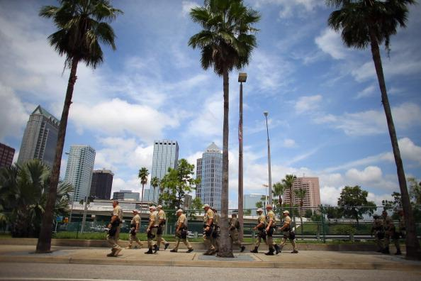 Law enforcement officers walk though the streets as they provide security for the Republican National Convention being held at the Tampa Bay Times Forum on August 25, 2012 in Tampa, Florida. The convention starts the week of August 27th. (Photo by Joe Raedle/Getty Images)