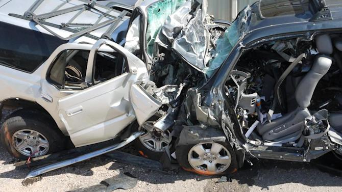 This photo taken Sept. 24, 2011, provided by the National Transportation Safety Board (NTSB), shows a post accident view of the vehicles from the Fountain, Colo. wrong-way collision. Hundreds of people are killed each a year when drivers turn the wrong-way into the face of oncoming traffic on high-speed highways, and a majority of the crashes involves drivers with blood alcohol levels more than twice the legal limit, a federal accident researcher said Tuesday. (AP Photo/NTSB)