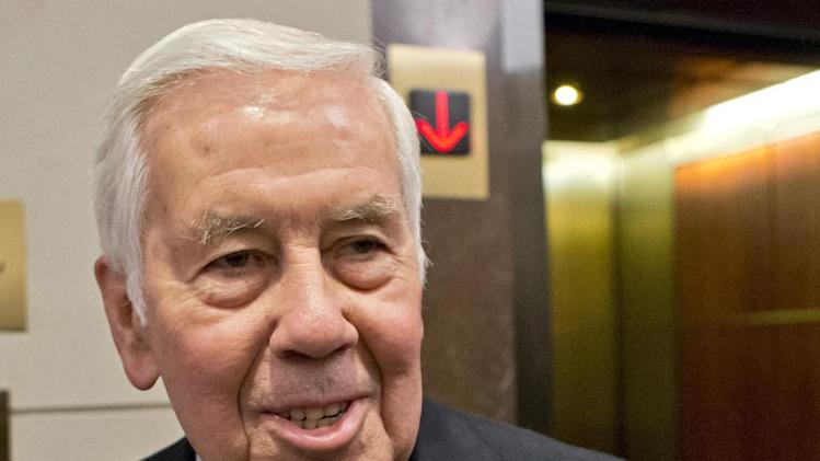 FILE - In this Nov. 13, 2012 file photo, then-Sen. Richard Lugar, R-Ind. is seen on Capitol Hill in Washington. Lugar is being knighted on orders from the Queen of England, joining a select list of Americans to receive the distinction. The Indiana Republican, who left the Senate earlier this year, will receive the rank of honorary Knight Commander of the Most Excellent Order of the British Empire during a ceremony at the British Embassy in Washington on Tuesday. The British Ambassador, Sir Peter Westmacott, is set to preside. (AP Photo/J. Scott Applewhite, File)