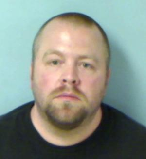 In this photo provided by the Westlake, Ohio, Police Department shows Scott A. Smith. Authorities in northeast Ohio say Smith, 37, who brought a loaded gun, ammunition and several knives to a weekend showing of the latest Batman movie did so to protect himself, not because he had sinister intentions.  (AP Photo/Westlake Police Department)