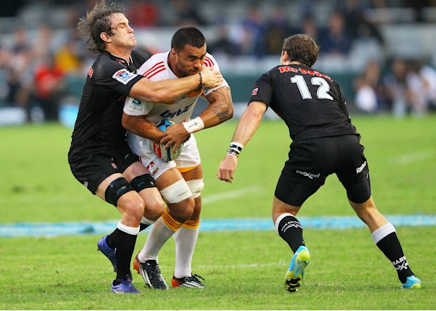 New Zealand Waikato Chiefs' Liam Messam (C) is tackled by Durban Sharks' Keegan Daniels (L) during a Super 15 rugby union match at the Mr Price Kings Park Rugby Stadium on April 21, 2012.  AFP PHOTO (