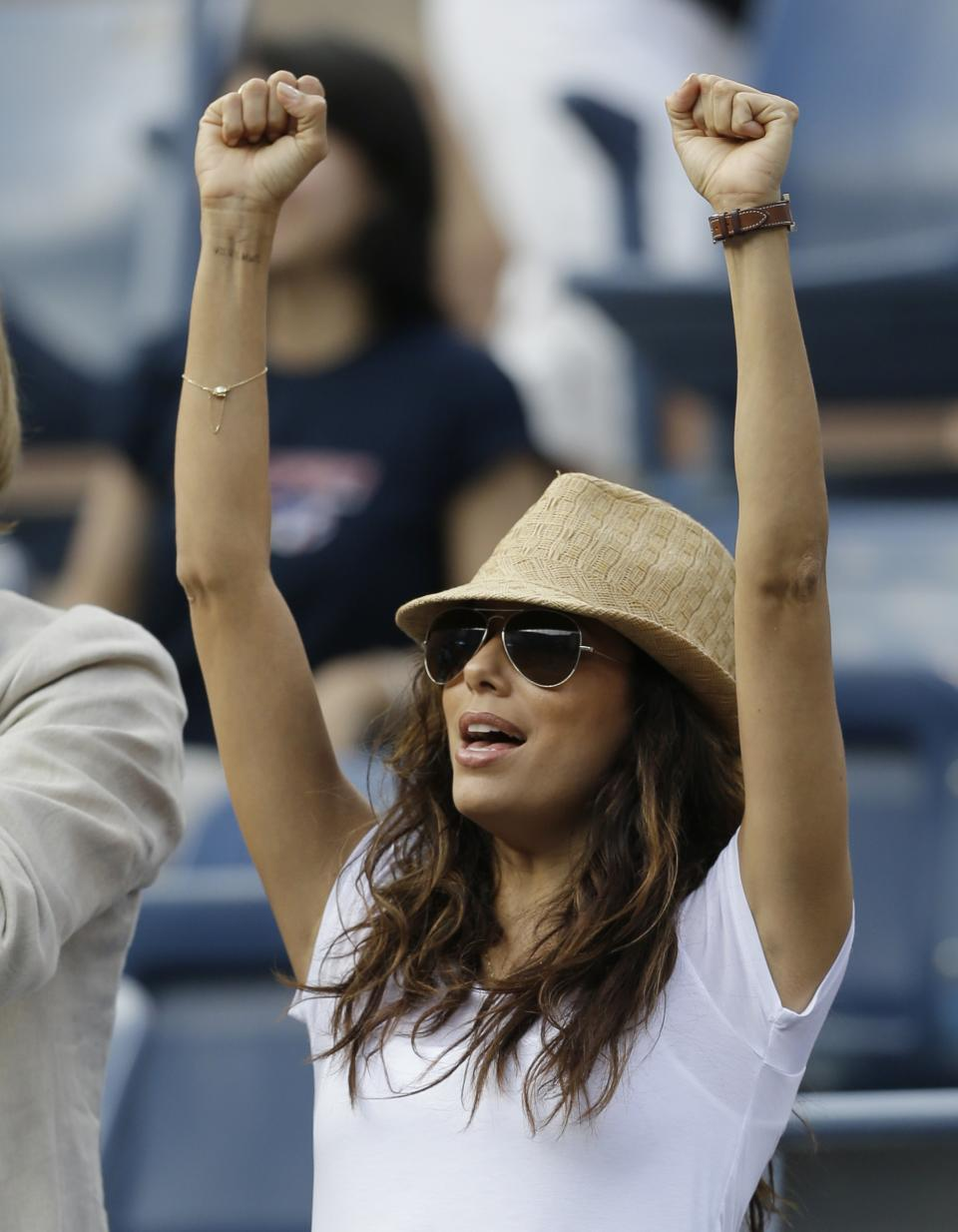 Eva Longoria cheers as Serena Williams and Sara Errani of Italy take the court to play in a semifinal match at the 2012 US Open tennis tournament,  Friday, Sept. 7, 2012, in New York. (AP Photo/Darron Cummings)