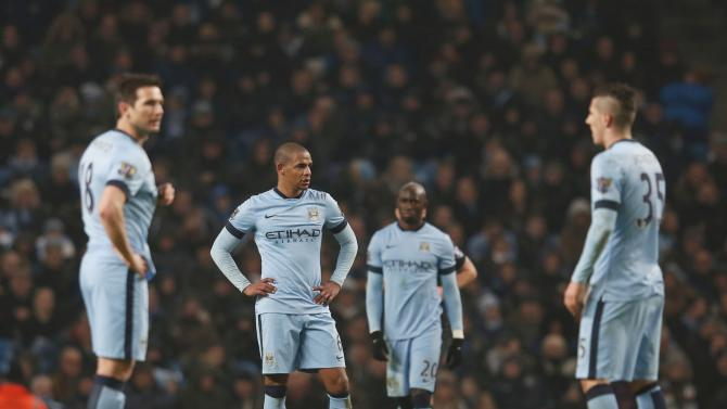 Manchester City players react after Burnley scored a second goal during their English Premier League soccer match at the Etihad Stadium in Manchester