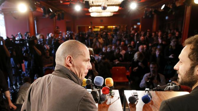 Greece's former Finance Minister Varoufakis and Croatian author Horvat address a news conference in Berlin