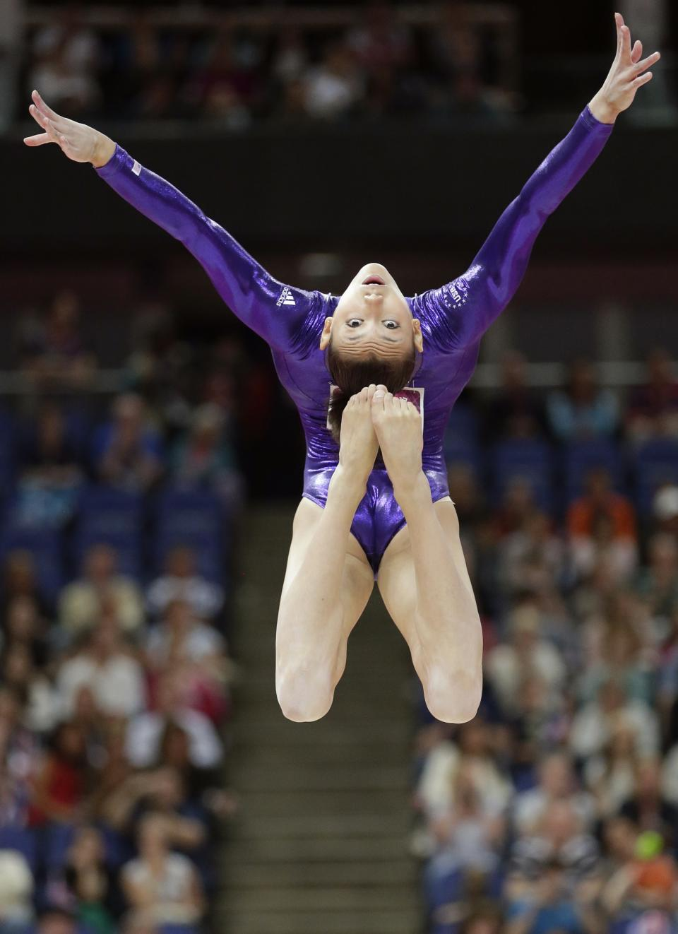 U.S. gymnast Kyla Ross performs on the balance beam during the Artistic Gymnastics women's qualification at the 2012 Summer Olympics, Sunday, July 29, 2012, in London. (AP Photo/Gregory Bull)