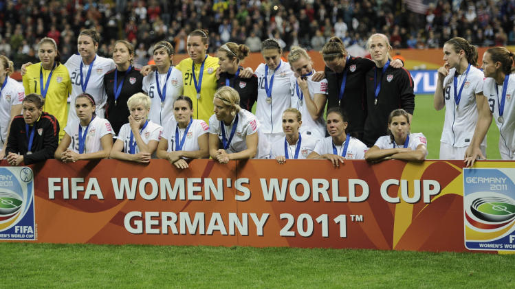 United States players pose for a photo following the final match between Japan and the United States at the Women's Soccer World Cup in Frankfurt, Germany, Sunday, July 17, 2011. The Japanese women's soccer team won their first World Cup Sunday after defeating USA in a penalty shoot-out.(AP Photo/Martin Meissner)