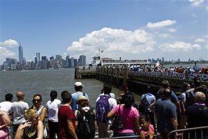 People wait in line to catch the ferry to Manhattan …