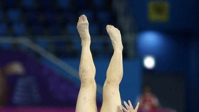 North Korea's Kim competes in the vault event of the women's individual all-around final artistic gymnastics competition at the Namdong Gymnasium Club during the 17th Asian Games in Incheon