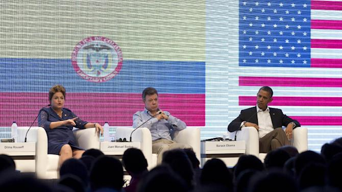 Brazil's President Dilma Rousseff, left, Colombia's President Juan Manuel Santos, center, and U.S. President Barack Obama participate in a three-way conversation at the CEO Summit of the Americas, in Cartagena, Colombia, Saturday April 14, 2012. Regional business leaders are meeting parallel to the sixth Summit of the Americas which brings together presidents and prime ministers from Canada, the Caribbean, Latin America and the U.S. (AP Photo/Carolyn Kaster)