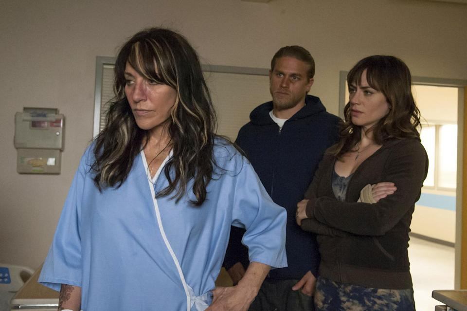 "In this undated publicity image released by FX, Katey Sagal portrays Gemma Teller-Morrow, from left, Charlie Hunnam portrays Jackson ""Jax"" Teller, Maggie Siff portrays Tara Knowles in a scene from ""Sons of Anarchy."" (AP Photo/FX, Prashant Gupta)"