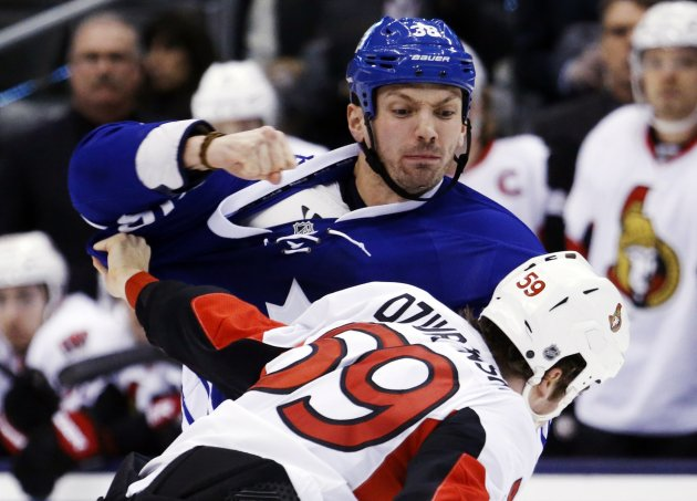 Toronto Maple Leafs' McLaren fights with Ottawa Senators' Dziurzynski during their NHL hockey game in Toronto