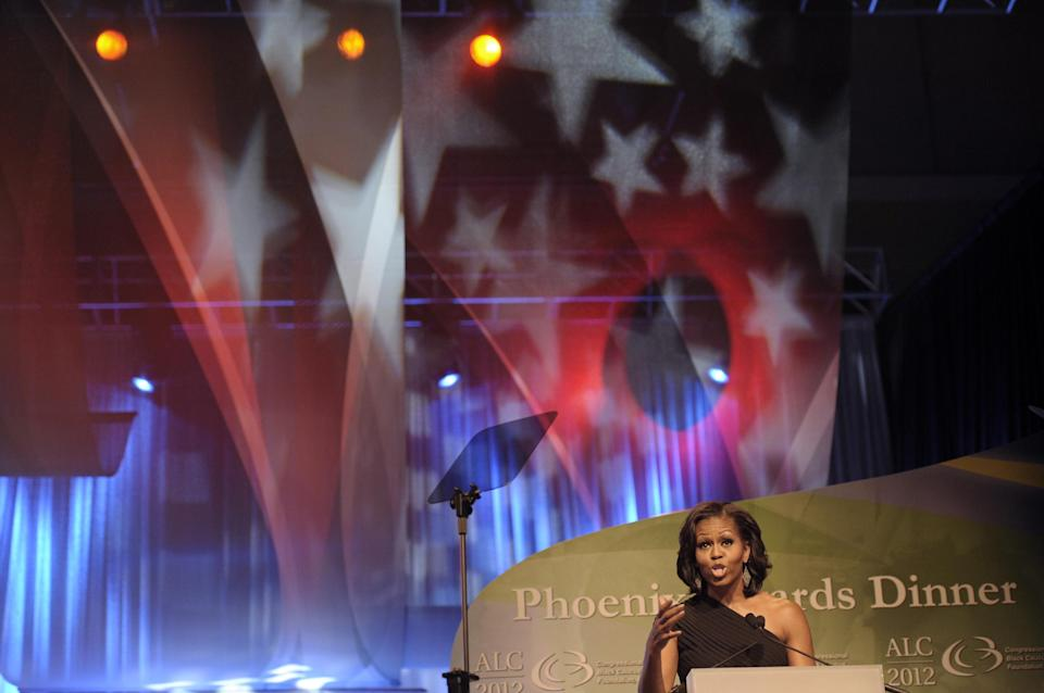 First lady Michelle Obama addresses the Congressional Black Caucus Foundation's 42nd Annual Phoenix Awards dinner in Washington, Saturday, Sept. 22, 2012. (AP Photo/Cliff Owen)