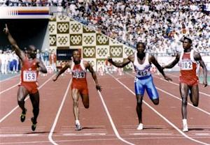 Johnson of Canada leads Smith, Christie and Lewis across the finish line to win the men's 100 meters sprint final at the Olympics in Seoul