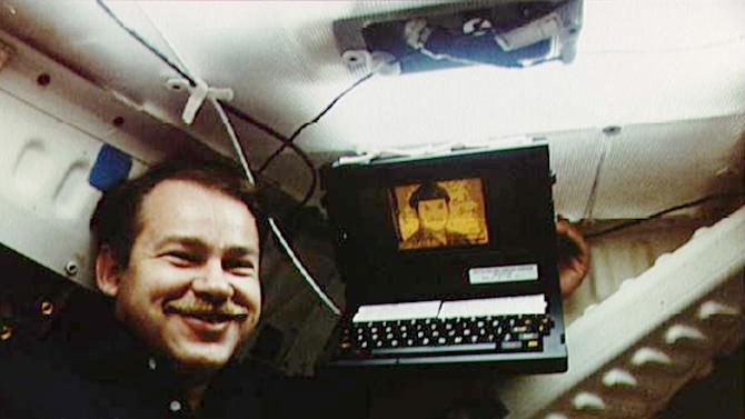In this June 18, 1985 photo made available by NASA, Astronaut John Creighton poses with the onboard Graphical Retrieval Information Display (GRID) computer, which displays a likeness of the character Mr. Spock from Star Trek. Bill Moggridge, who designed the GRID computer, an early portable with a flip-open shape that is common today, has died. He was 69. The Smithsonian's Cooper-Hewitt, National Design Museum said Moggridge, its director since 2010, died on Saturday, Sept. 8, 2012 after a battle with cancer. (AP Photo/NASA)