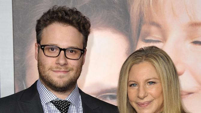 """Cast members Seth Rogen, left, and Barbra Streisand attend the LA premiere of """"The Guilt Trip"""" at the Regency Village Theater on Tuesday, Dec. 11, 2012, in Los Angeles. (Photo by John Shearer/Invision/AP)"""