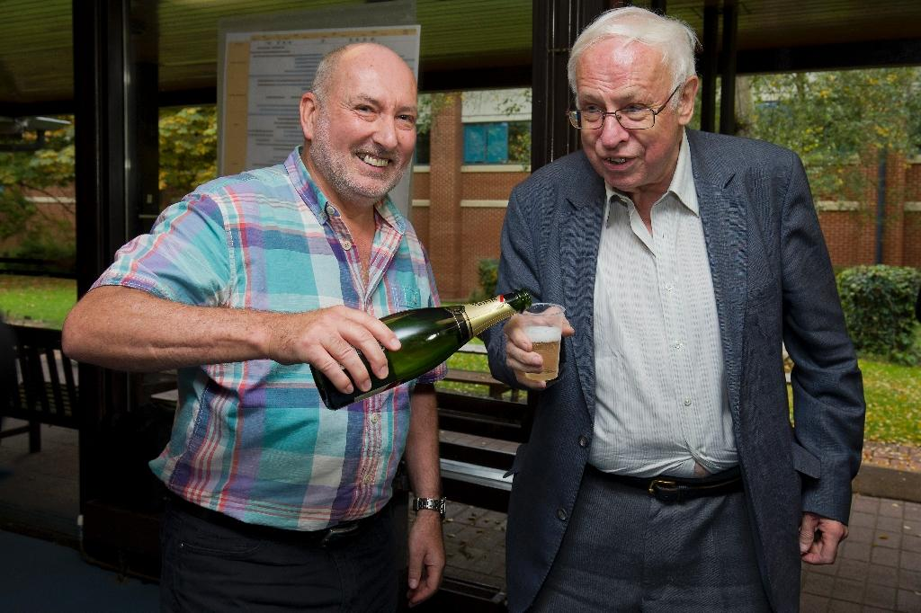 Lindahl celebrates Nobel with plastic cup of champagne