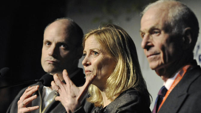 Mary Wittenberg, president of the New York Road Runners, speaks during a news conference Friday, Nov. 2, 2012, in New York, after New York Mayor Michael Bloomberg canceled Sunday's New York City Marathon. At left is Howard Wolfson, deputy mayor for government affairs and communication; at right is George Hirsch, chairman of the board of New York Road Runners. Bloomberg canceled the race after mounting criticism that this was not the time for a race, as the city continues to recover from Superstorm Sandy. (AP Photo/ Louis Lanzano)