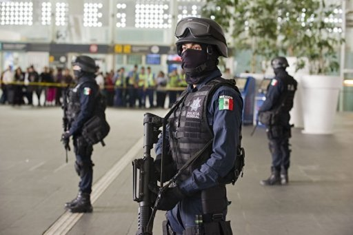 Federal Police officers stand guard at Benito Juarez international airport Terminal 2
