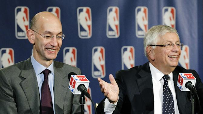 NBA Deputy Commissioner Adam Silver, left, laughs as Commissioner David Stern gestures toward him during a basketball news conference following Board of Governors meetings in New York, Thursday, Oct. 25, 2012. Stern announced he will retire on Feb. 1, 2014, 30 years after he took charge of the league. He will be replaced by Silver. (AP Photo/Kathy Willens)