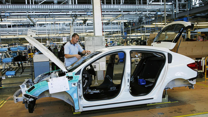 FILE - In this undated file photo released by General Motors Co., a Holden Cruze hatch is manufactured at a plant in Australia. General Motors Co. said Wednesday, Dec. 11, 2013, it will stop making cars and engines in Australia by the end of 2017, with nearly 2,900 jobs to be lost, because of high production costs and competition. GM's Australian subsidiary Holden once dominated Australian auto sales, but lost market share to imported cars. (AP Photo/General Motors, File)