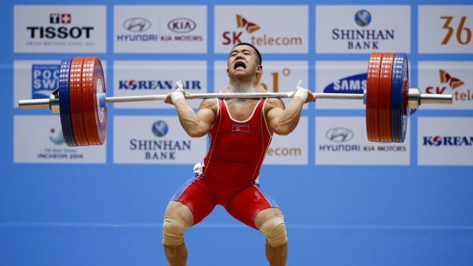 North Korea's Om competes in the men's 56kg clean and jerk weightlifting competition at the Moonlight Festival Garden during the 17th Asian Games in Incheon