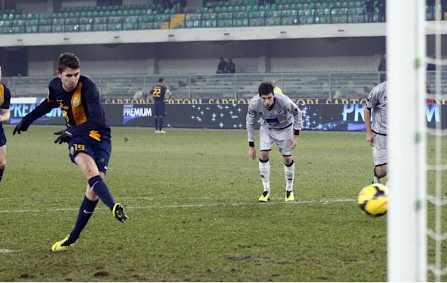 Hellas Verona's forward Jorginho, of Brazil, scores on a penalty kick during a Serie A soccer match against Atalanta at the Bentegodi stadium in Verona, Italy, Sunday, Dec. 8, 2013. Verona won 2-1