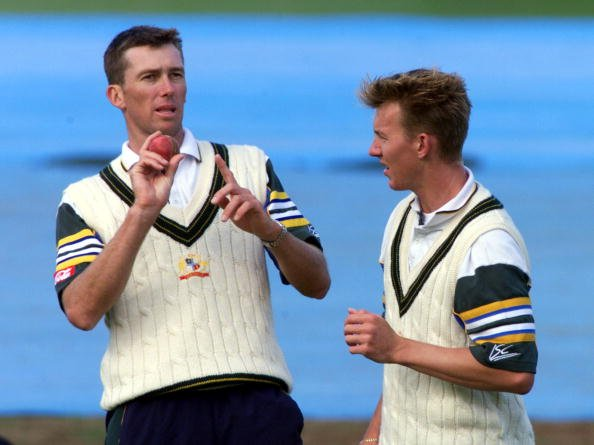 Australians Glenn McGrath, left and Brett Lee swap