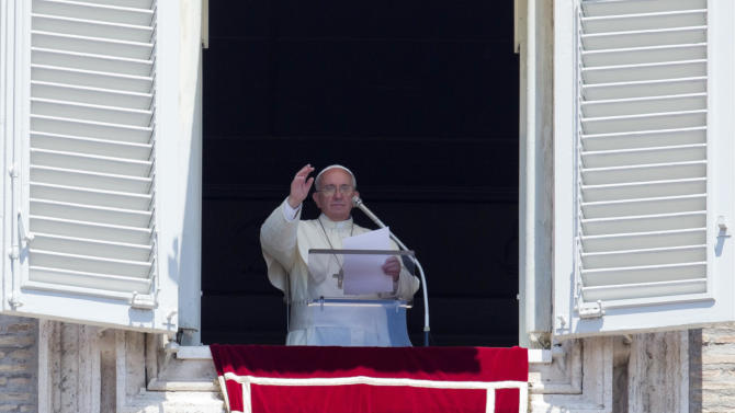 Pope Francis celebrates the Angelus noon prayer from his studio window overlooking St. Peter's square, at the Vatican, Sunday, July 6, 2014. (AP Photo/Alessandra Tarantino)