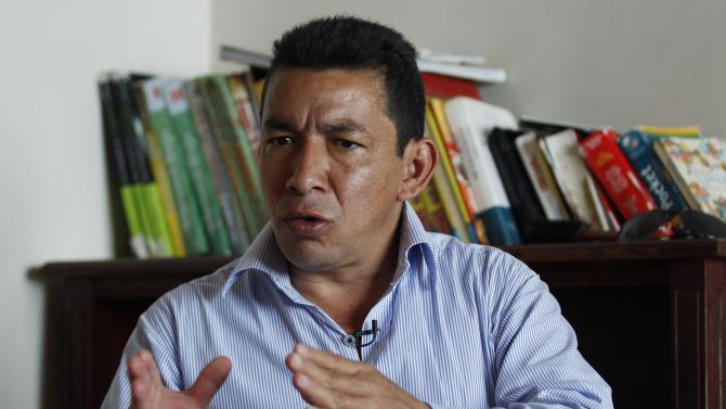 """In this Saturday, Jan. 26, 2013, Jose Crisanto Gomez, a farmer who was given a 7-month-old baby by Colombian rebels for caring, speaks during an interview in Duitama, Colombia. The Spanish and French filmmakers of """"Operation E,"""" say they were intrigued by Gomez's story because he claimed not to have known that the fair-skinned baby brought to him by rebels was born to political hostage Clara Rojas. Rojas gave birth to the baby boy in 2004 while a hostage of Revolutionary Armed Forces of Colombia, has asked a court to prevent the film, """"Operation E,"""" from being shown in the country, saying it would harm her child and """"the free development of his personality."""" (AP Photo/Fernando Vergara)"""