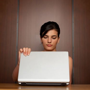 Woman-closing-laptop_web
