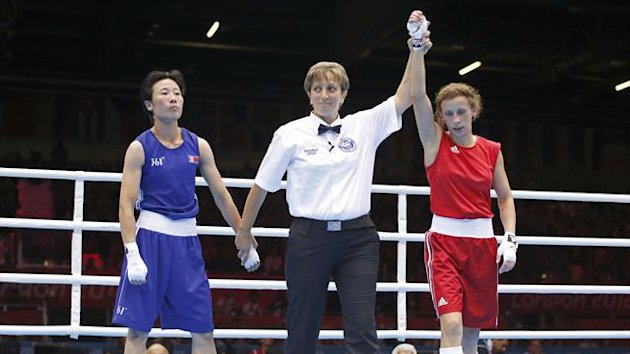 Russia's Elena Savelyeva (R) wins against North Korea's Kim Hye Song during their Women's Fly (51kg) Round of 16 boxing match during the London 2012 Olympic Games