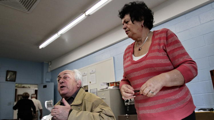 """In this photo taken on Nov. 17, 2010, Joseph Tokar, 75, left, and Klara Rakhlin, 72, both Holocaust survivors from the former Soviet Union, attend a weekly meeting of survivors in the Brooklyn borough of New York.  """"I cannot imagine that someone would lie like that; it's a terrible crime,"""" says Rakhlin of the 17 people, mostly Brighton Beach residents arrested on charges they faked stories of Holocaust survival to profit from money meant for survivors of Nazi persecution.  """"I lost my family in a concentration camp, and it's disgusting that people would get compensation although they haven't suffered."""" (AP Photo/Bebeto Matthews)"""