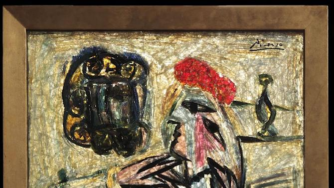 """This photo provided by the Evansville Museum of Arts, History & Science shows Pablo Picasso's """"Seated Woman with Red Hat"""" (""""Femme assise au chapeau rouge""""). The Evansville Museum plans to sell the layered, fired glass piece that it has kept in storage nearly 50 years and only recently discovered was genuine, because it is to expensive to keep. It is not known how much it is worth. (AP Photo/courtesy Evansville Museum of Arts, History & Science, Michael Wheatley)"""