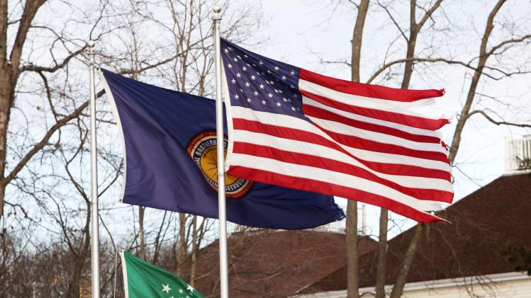 A flag in remembrance of the victims of the shootings at Sandy Hook Elementary School with 6 large and 20 small stars is seen with the U.S. and IBEW flags in Monroe