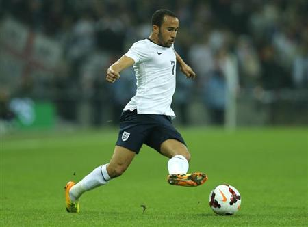 England's Andros Townsend runs with the ball during their 2014 World Cup qualifying soccer match against Poland at Wembley Stadium in London