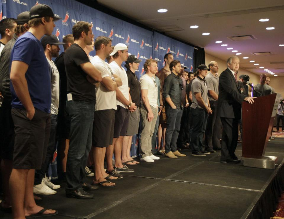 NHL Players Association executive director Donald Fehr, right, is joined by hockey players as he speaks to reporters during a news conference in New York, Thursday, Sept. 13, 2012. Fehr says a lockout can be avoided and that's up to the league. (AP Photo/Mary Altaffer)