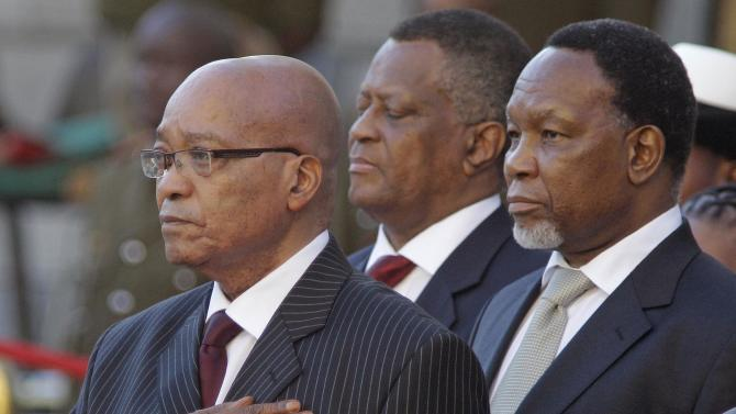 FILE - In this Thursday, Feb. 9, 2012 photo South African president Jacob Zuma, left, and deputy president Kgalema Motlanthe, right, during the opening of Parliament in Cape Town, South Africa. South Africa's governing African National Congress will see Zuma compete against his soft-spoken deputy next week at a convention where members will pick who will lead the political party into the future _ and who will be in line to be the nation's likely next president . (AP Photo Schalk van Zuydam, File)