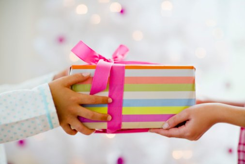 Exchanging gifts can bring a smile to anyone&#39;s face.