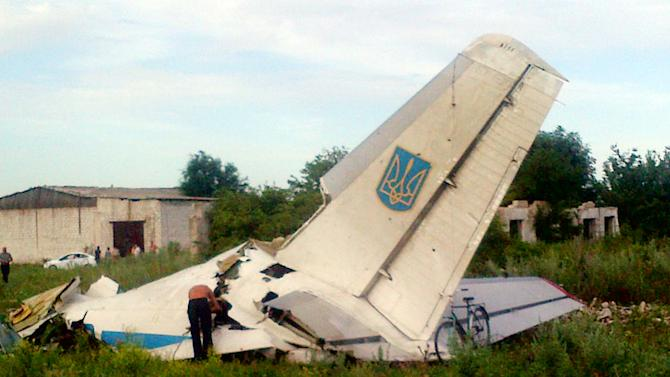 Fragments of a Ukrainian AN-26 transport aircraft are seen near the village of Davido-Nikolsk, in Ukraine's Lugansk region, on July 14, 2014