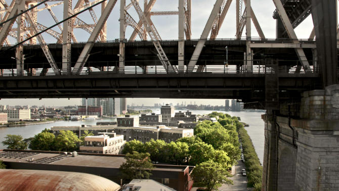 In this May 17, 2012 photo, a view is shown of the Coler Goldwater Specialty Hospital & Nursing Facility, an acute long-term care hospital facility on Roosevelt Island, under the span of the 59th Street Bridge, in New York. The Technion-Israel Institute of Technology in Haifa, Israel, is partnering with New York's Cornell University to create CornellNYC Tech, a 10-acre $2 billion campus, to replace the  facility located on Roosevelt Island's southern end.  (AP Photo/Bebeto Matthews)