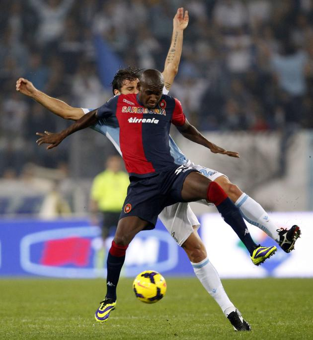 Lazio's Cana challenges Cagliari's Ibarbo during their Italian Serie A soccer match at the Olympic stadium in Rome
