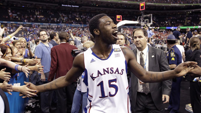 Kansas guard Elijah Johnson (15) celebrates after their 64-62 win over Ohio State in an NCAA Final Four semifinal college basketball tournament game Saturday, March 31, 2012, in New Orleans. (AP Photo/David J. Phillip)