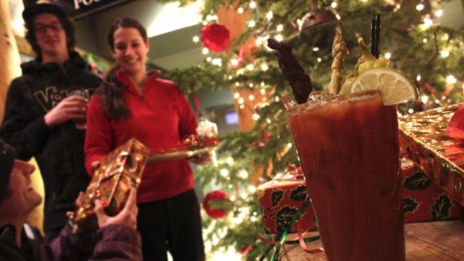 This undated image provided by Moonlight Basin Resort in Big Sky, Mont., shows a bloody mary served at the resort that's made with vodka from Montana's Vigilante distillery, topped off with a bit of locally sourced elk jerky. The cocktail is one of a number of specialty drinks offered for the apres ski crowd at resorts and hotels around the West. (AP Photo/Moonlight Basin Resort)