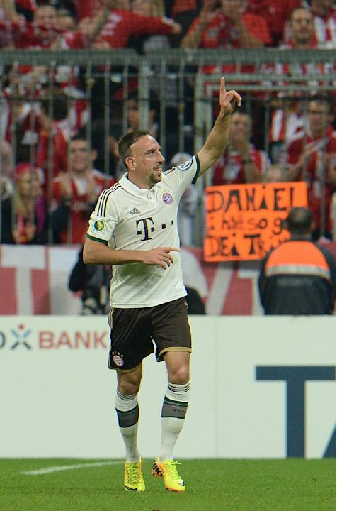 Munich's Franck Ribery of France celebrates after scoring during the German soccer cup second round match between FC Bayern Munich and Hannover 96, in Munich, southern Germany, Wednesday, Sept. 25, 20